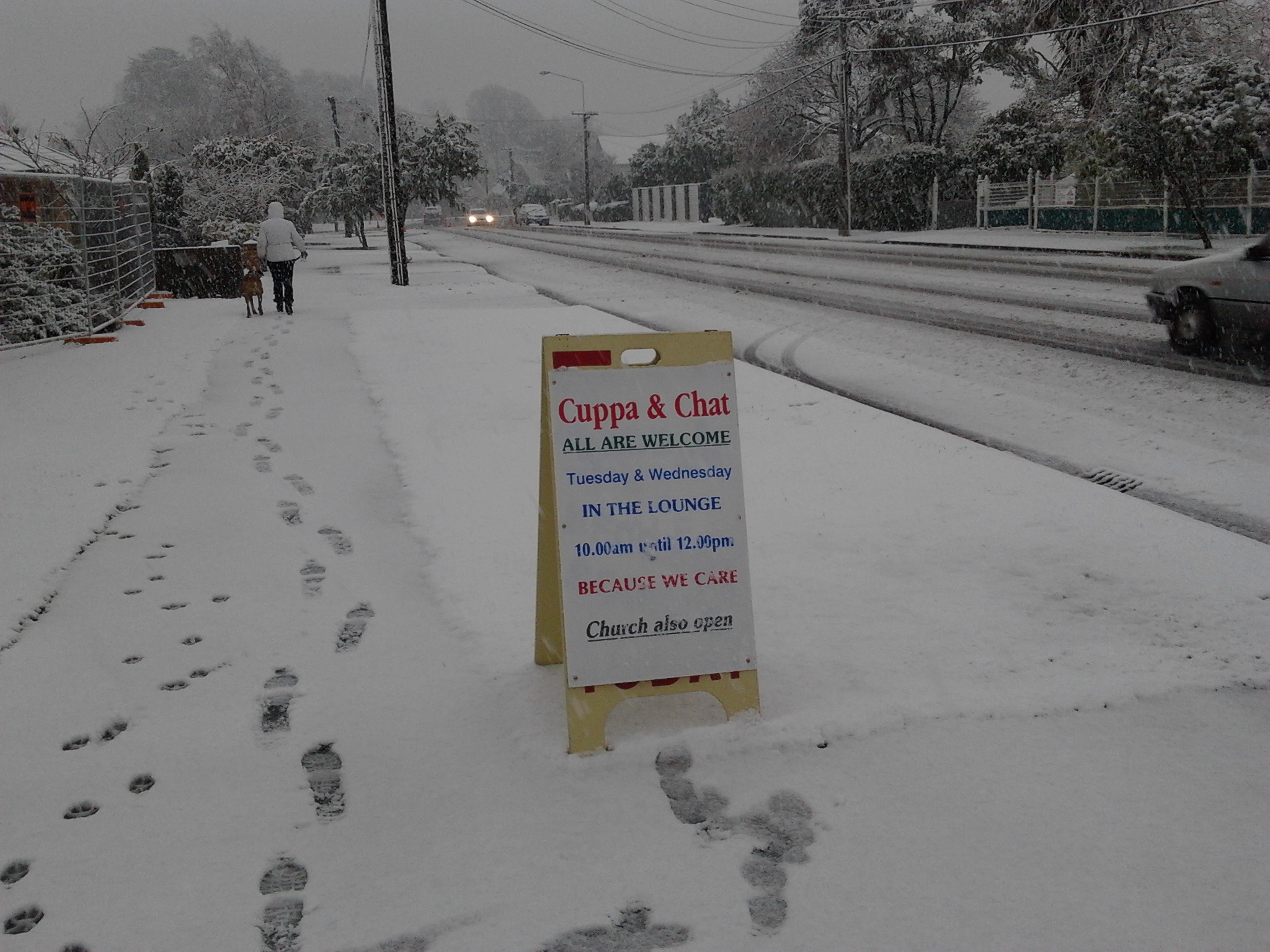 Footsteps and Open sign in snow outside church