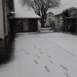 footsteps in snow leading up to the church door